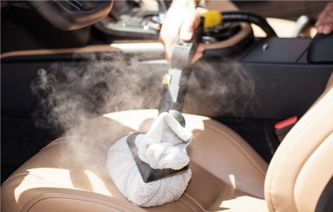 Car interior leather steam cleaning application