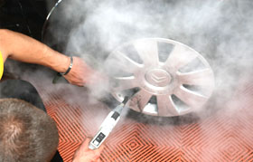 car wheel cleaning with steam vapour