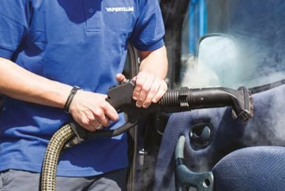 Dry steam vapour vacuuming trims in car
